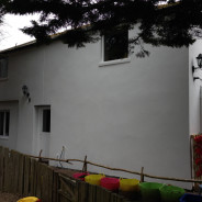 exterior of coach house in worthing pressure washed , prepared and decorated by allday property maintenance